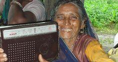 Woman holding a radio, Madhya Pradesh, India.