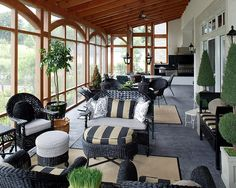 I want a space like this... so beautiful! Screened in porch