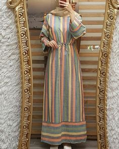 Image may contain: 1 person, standing and stripes Modern Hijab Fashion, Arab Fashion, Islamic Fashion, Modest Fashion, African Fashion, Fashion Dresses, Hijab Evening Dress, Moslem Fashion, Hijab Style Dress