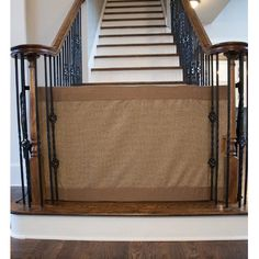 "Stair Barrier Banister To Banister Signature Gate - Size: 32"" H x 36"" - 42"" W, Mocha, Regular. One of the best features (similar to a retractable gate) of the product is that it rolls to the side and out of the way when you don't need it^Designed specifically for the bottom of the stairs and available in two sizes, all Stair Barriers are 32"" inches tall^Made with high quality class 1 upholstery grade fabric, heavy duty polypropylene webbing, dual sided release buckles and internal rigid..."