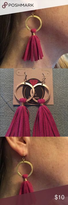 Leather tassel earrings Hot pink leather tassel earrings with a gold ring at the top. All $10 earrings are 2 for $16 or 3 for $20 Jewelry Earrings