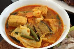 Sayur lodeh  is a vegetable curry commonly found in Malaysia, Singapore and Indonesia. The version I grew up with contains cabbage, eggpl...