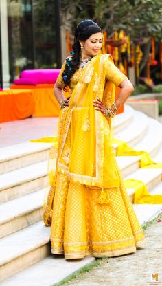 yellow banarsi lehenga , elbow length sleeves , yellow mehendi lehenga , haldi lehenga , suster of the bride lehenga , banarsi silk lehenga skirt, bright lehenga , lightweight lehenga