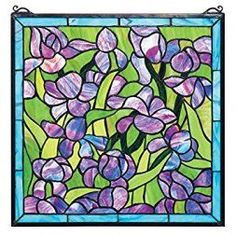 I absolutely love glass home wall art décor as it is rare,  stunningly beautiful and absolutely timeless when it comes to elegant home décor.  Moreover, I love the colorful glass wall  decorations.  Indeed, these decorative  accents are simply charming, unique and trendy in homes around the world.  #homedecor #wallart #glassart      Design Toscano Saint-Remy Irises Stained Glass Window