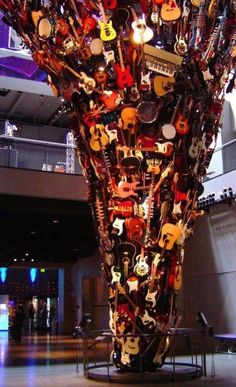 (Seattle) i MUST see this one day! The Guitar Tornado: This sculpture is in the entrance to Paul Allen's Experience Music Project, which is right next to the Space Needle in Seattle. Seattle Washington, Washington State, Sleepless In Seattle, The Meta Picture, Evergreen State, Guitar Art, Oh The Places You'll Go, Pacific Northwest, Cool Stuff