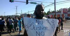 Live Showdown: Black Activists Go Head-to-head Against Ferguson Riot Police
