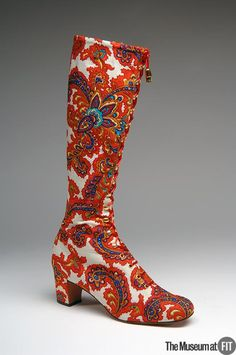 """Tony the Shoemaker Medium: Printed rayon challis with gold-tone metal Date: c.1970  Country: USA  These """"granny"""" boots are a high fashion version of counterculture style, which embraced disparate elements of non-Western dress. The paisley pattern, traditionally associated with India, has in these boots been modernized with the artificially bright colors of the late 1960s and early 1970s."""