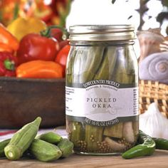 "When it comes to pickled foods, okra is in a class of its own!  Crisp on the outside, buttery soft on the inside… even the little okra seeds are steeped in pickle flavor.  A delightful finger food-- they also make a tasty & unique martini or bloody Mary garnish. Traditional ""Low Country"" classic!  16 oz. Handmade & handpacked. Product of USA."