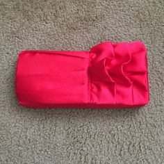 Red clutch The clutch can be turn into a crossbody. It can be taken to parties if you don't want to carry a big purse. The fabric is very soft; silky. The Touch of Nina Bags Clutches & Wristlets