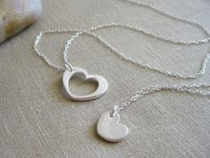 Heart Necklace Set - I want a necklace like this, except with two little hearts for each of my girls