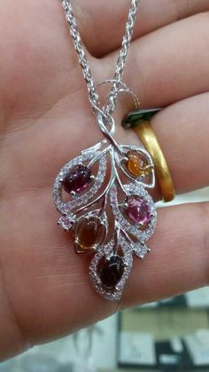 silver pendant embedded with natural gems.