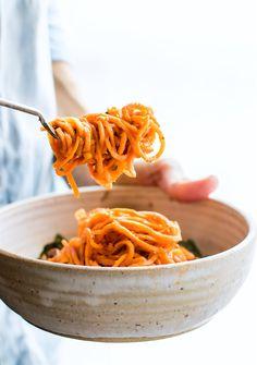 Sweet Potato Spaghetti made with spiralized sweet potatoes in zesty tomato sauce. Easy Italian Sweet Potato Spaghetti bowls that are quick, paleo, & vegan!
