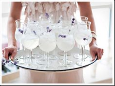 Lavendar Lemonade ~  1-1/2 ounces Vodka (or Gin) 1 ounce lavender syrup. 1 to 1-1/2 ounces fresh lemon juice Sparkling water  (To make the lavender syrup: bring 1 cup water, 1 cup sugar and the zest of one lemon to a boil; remove from heat, then add 1 cup lavender blossoms. Let steep overnight, then strain and bottle) Fill a highball glass with ice, add the syrup, lemon juice and vodka, then top with sparkling water. You may leave out the vodka to make it nonalcoholic.