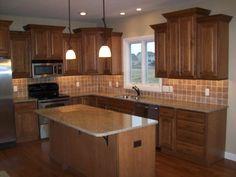 Image result for backsplash and countertops for oak cabinets