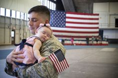 This photograph captured the first time James Glass (United States Air Force) got to see and hold his new daughter, Eva.   Eva was up at 3am waiting for her daddy's flight to land.  She quickly fell asleep in the comfort of his arms while still holding her American flag.   It was a very emotional photograph to take as it made me realize how much our servicemen and women sacrifice  for our freedom.  (October 2014)