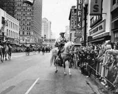 Stellar photograph of Roy Rogers riding Trigger in the parade at the opening of the Houston Livestock Show, Feb. 1952. Photographed by Moon Young.