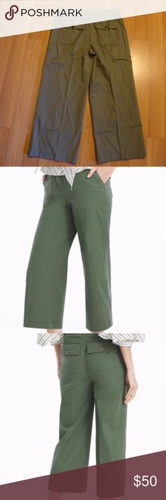 """WHBM The Wide Leg Crop Military Green 12 Long BNWT WHBM WIDE-LEG CROP PANTS Color: Military Green  Size: 12 Long  Approximately 11"""" Rise, Inseam 26"""", Waist 17""""  Wide-leg crop pants in military green Zip fly with hidden double hook-and-eye closure Goldtone D-ring belt detail; side and back pockets 97% Cotton / 3% spandex. Machine wash cold White House Black Market Pants Ankle & Cropped"""
