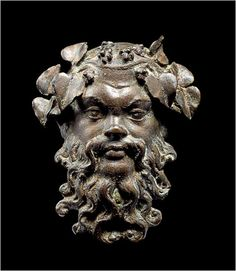 Afghanistan's Hidden Treasures -   A  bronze mask of Silenious from Bregam. Kabul  Museum Bactrian culture.