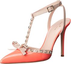 Kate Spade New York Women's Lydia Geranium Patent/Pale Pink Nappa Sandal. Engage his interest. Linger in the illustrious luxury of the Lydia by Kate Spade™!. Luxurious patent leather upper. Adorned with thrilling sparkling stones. T-strap style with buckle closure at the ankle. Pointed toe. Leather lining. Lightly cushioned leather footbed. Leather sole. Made in Italy. Measurements: Heel Height: 4 in Weight: 7 oz Platform Height: 1⁄4 in Product measurements were taken using size 7.5…