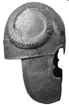 Treasure-Filled Warrior's Grave Found in Russia.  This bronze helmet, found on the surface of the necropolis, depicts curled sheep horns carved in high relief.