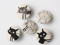 Cat buttons! Gorgeous (although I wish they were badges, rather than buttons - my daughter and her friends would love wearing these).