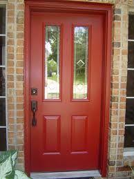 double doors with aged bronze handles - Google Search brown brick, red door, aged bronze.....it works!