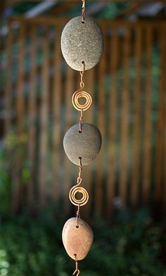 This beautiful wind chime features 3 natural Pacific beach stones. There are hammered copper spirals between each stone. The 5 copper chimes are treated with a reactive-- not paint: this finish will n