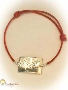 """Handcrafted fine silver bracelet with a 'Creator' medallion attached to an adjustable red leather cord. The words """"I'M A CREATOR"""" are handcarved. No 227 The medallion measures 17mm in height and 25 mm in width. It is high polished and matt on the back. It reminds you of what you are: a CREATOR!"""