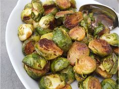TESTED & PERFECTED RECIPE - Brussels sprouts roasted until golden brown and crisp, and then tossed with a touch of balsamic vinegar and honey. Vegetable Side Dishes, Vegetable Recipes, Vegetarian Recipes, Cooking Recipes, Vegetarian Cooking, Chef Recipes, Cooking Ideas, Healthy Cooking, Yummy Recipes