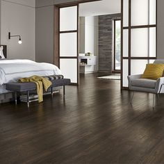 Java Scraped Oak natural laminate floor with wear and spill protection. Brown oak wood finish, 10mm thick, 1-strip plank laminate flooring, 10-year warranty.