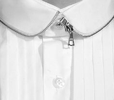 Over the years zippers have transitioned from practical use to being used as part of design details. This collar features a silver zipper as part of the trim for a shirt collar. This is a good example of how a zipper can provide design interest without serving a practical function.