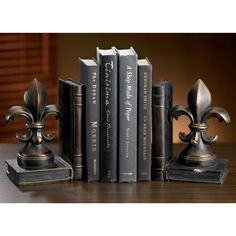 A beautiful addition to any home or office, this impressive decorative set of fleur de lis bookends is cast in resin and finished in an antique faux bronze patina. This pair of finely detailed bookends will accent your favorite volumes in grand splendor.