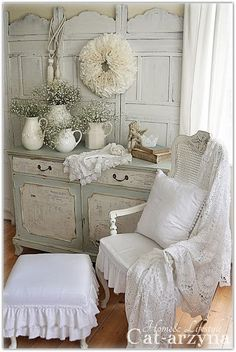 So many great ideas in this one photo - love the milk painted dresser with vintage paper inserts, iron ware pitchers with baby's breath, and coffee filter wreath on the wall - great blog Cat-arzyna!