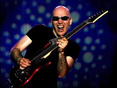 Google Image Result for http://www.guitarlessons.com/wp-content/themes/glTemplate/images/guitarist/rock/joe-satriani-7.jpg