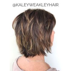 Feathered Bob With Bangs And Highlights