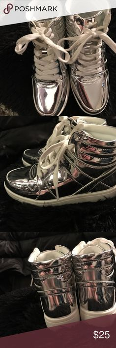 Girls silver hi tops Silver metallic hi top sneakers!!! So cool look awesome on.. u can dress them up or down because they are shiny... my daughter fell in love with them but she never got to wear them because she ordered wrong size.  They were never worn, even though both my daughters wanted to so bad!!!! They are really cool they are brand new but we threw away box Justice Shoes Sneakers