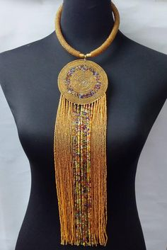 African beaded necklace made with maasai beads.Its a perfect accessory that will match most of your outfits.Suitable for any season.A good gift to your friends and loved ones.All our items are shipped through DHL Express. Delivered between 3 to 5 days. African Beads Necklace, African Jewelry, Ethnic Jewelry, Beaded Earrings, Beaded Jewelry, Nice Jewelry, Handmade Jewellery, Jewelry Sets, Jewlery