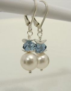 Pearl wave: Swarovski pearl and crystal earrings with wavy disc, sterling silver by jewelrycreations for $20.00