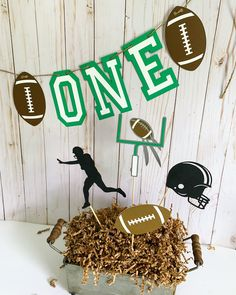 Designed by Declan & Smith Party Decor, this football banner is the perfect addition to your football themed birthday party or football game day celebration. Machine cut and handcrafted with attention to detail, the football age banner is made with high quality, it comes in many phrases such as Game Day, Concessions, Touchdown, My Rookie, Year, etc. #football #footballbirthdaydecorations #gameday #concessions Football Centerpieces, Baseball Party Decorations, First Birthday Party Decorations, Football First Birthday, Sports Birthday, Football Phrases, Football Banner, Fall Birthday Parties, First Birthdays