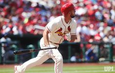 St. Louis Cardinals Paul DeJong drops his bat after hitting a solo home run in the third inning against the New York Mets at Busch Stadum…