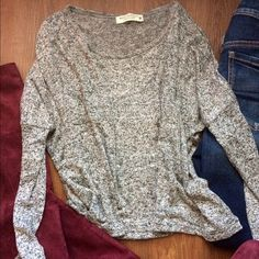 🍂Soft and slouchy round collar sweater🍂 Incredibly soft and slouchy round collar sweater. Has sort of a wide cute (as shown in 3rd pic) but still looks flattering on (pic 4)! Lovely heather grey color. Perfect for kicking off fall! 🍃🍂🍁 Brand new, never worn. NWOT. NO TRADES SO PLEASE DONT ASK!! Please make all offers through the offer button! Fits basically all sizes (I'm modeling a MED but normally wear SM/XS and still looks good) Sweaters