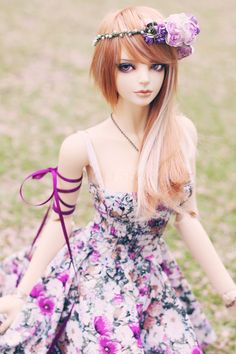 Gorgeous bjd, i think a pic from deviantart. Purple flower bjd lady