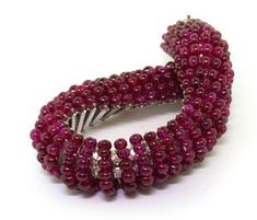 BHAGAT. AN IMPORTANT RUBY BEAD AND DIAMOND BRACELET.