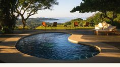 Relax with jungle and #Pacific Ocean views in our natural pool. #Nosara #CostaRica