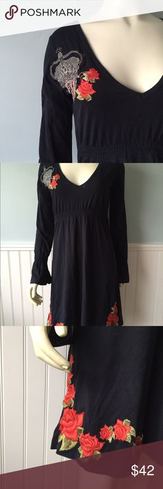 "Black tunic dress rose embroidery rock rebellion JWLA JOHNNY WAS BLACK COTTON KNIT DRESS/tunic TAG SIZE IS small.  100% COTTON. HAS RED ROSE EMBROIDERY AT HEMLINE.  HAS ELASTIC AT FRONT EMPIRE WAIST, V NECK FRONT, ""ROCK & REBELLION"" ON UPPER BACK. LONG SLEEVES WITH ELASTIC NEAR BOTTOM. Johnny Was Tops Tunics"