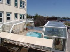 Roll-A-Cover's patio retractable roof system allows for year-round use of an outdoor patio space while maintaining an outdoor ambiance. When the weather is inclement, the retractable enclosure closes. When the weather permits, the retractable roof opens! Screen Enclosures, Patio Enclosures, Swimming Pool Enclosures, Swimming Pools, Outdoor Pool, Outdoor Spaces, Retractable Pool Cover, Glass Pool, Roofing Systems