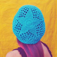 This is a mesh slouchy hat with a star design on the back! It's light and lacy, making it the perfect hat for Spring or even Summer! The