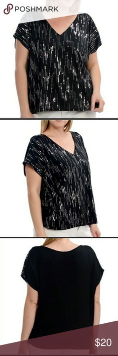 SILVER AND BLACK SEQUINS TOP SILVER SEQUINS IN A VERTICAL DESIGN DOWN THE FRONT. THIS TOP HAS A V NECKLINE RAYON/SPANDEX Bellino Clothing Tops