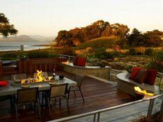 terrassenüberdachung feuerstelle gartenmöbel sonnenuntergang