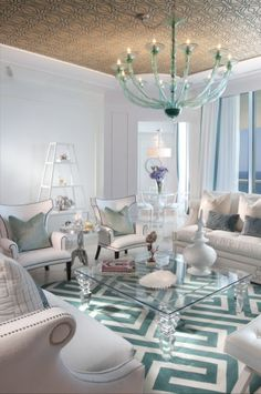 I like this room setting a lot! It's got a modernistic art deco feel to it! It's simple, elegant, and chic! I especially like the chandelier! It's so unique, it kinda reminds me of the framework of an umbrella! The pastel blues and eggshell tones of this room are spectacular! I like the pattern n the ceiling too! This room is fabulous! ;) <3